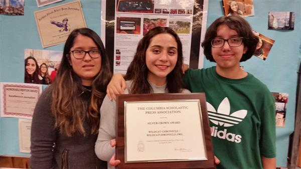 Wildcat Chronicle student journalists holding Silver Crown Award.